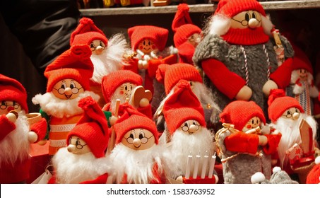 A group of colorful Christmas dwarfs with red caps and long, white beards.