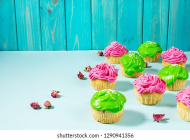 Group of colorful cupcake on blue background. Copy space