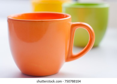 Group of colorful cups on bright background. Good morning mood after awakening concept.