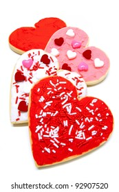 Group of colorful heart-shaped Valentines Day cookies with icing over white