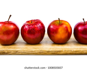 A group of colorful juicy apples on a wooden oak plate isolated on a white background