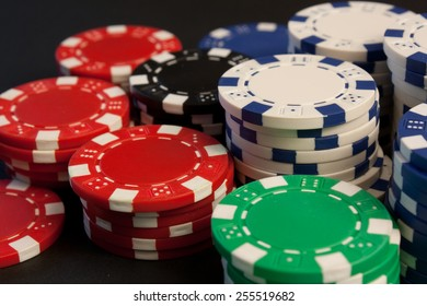 A group of colorful poker chips stacked up.