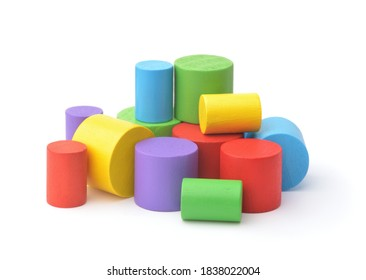 Group of colorful wooden toy cylinders isolated on white