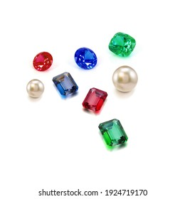 Group of colourful gems and pearl on the background.Translucent precious gemstones with light reflections
