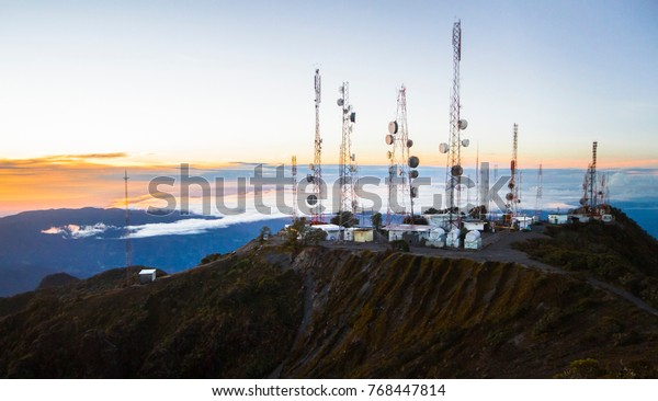 A group of communications towers on top of Panama's highest peak, Volcan Baru, at sunrise.