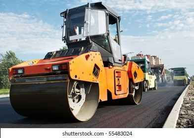 Group of compactors and Heavy Vibration rollers at asphalt pavement works (road repairing)