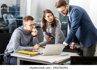 Group of company coworkers  at the office  discuss about  business strategy of  new investments.