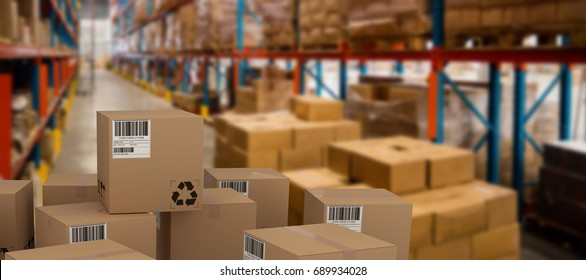 Group of composite cardboard boxes against boxes on pallet by rack