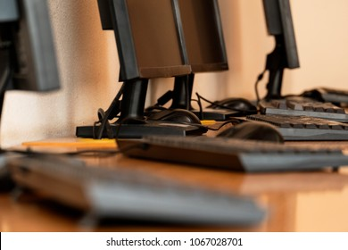 Group of computer neatly placed in a computer lab shallow dof image from table level
