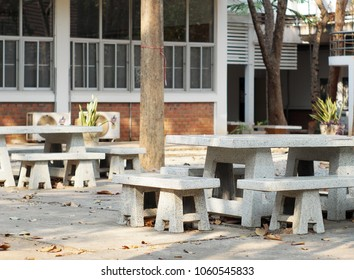 group of concrete bench and table sets installation in outdoor self learning and waiting area of a tropical school for relax group discussion in spring and summer time