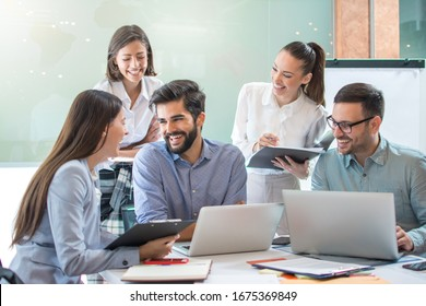 Group of confidence business people working together in the office.
