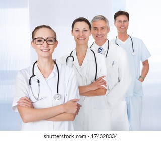 Group Of Confident Doctors Standing In A Row With Stethoscope