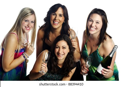 Group of confident young models celebrating with a bottle of champagne against white background