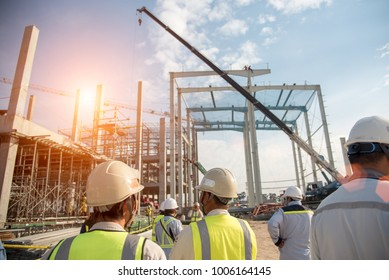 Group of construction engineer team in standard safety uniform work planing in construction site