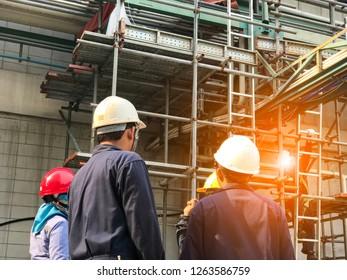 Group of construction engineer team,  Standard construction safety and construction site.