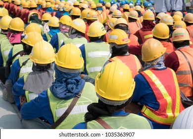 Group of construction worker helmet and safety uniform meeting on morning talk before work at warehouse under construction site