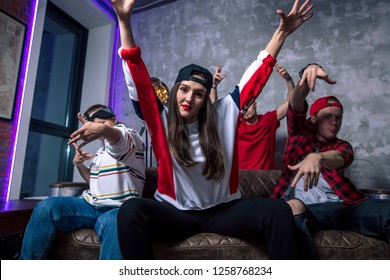 Group of cool emotional guys hanging out in the room. Hip-hop style. song lovers. young people are crazy about rap