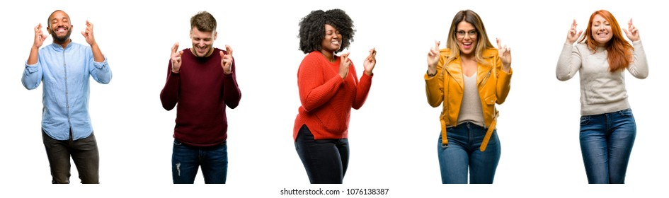 Group of cool people, woman and man with crossed fingers asking for good luck