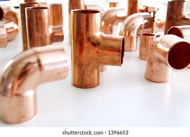 group of copper plumbing hardware