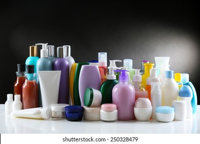 Group of cosmetic bottles on dark background