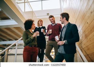 Group of coworkers having a coffee break
