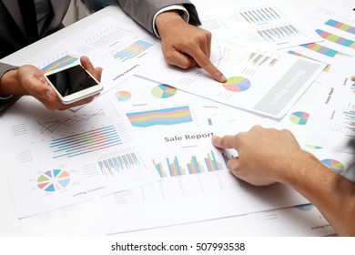 Group coworkers having discussion during meeting. Marketing Experience, business people exploring market data for organization development and market sharing, sale report
