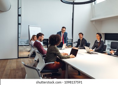 Group of coworkers having a meeting in a boardroom