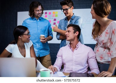 Group of coworkers interacting in the office