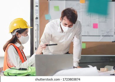 Group of creative building architect construction engineer project meeting and brainstorm together. Industry, Engineer, construction concept. Members wear face mask prevent covid-19 virus