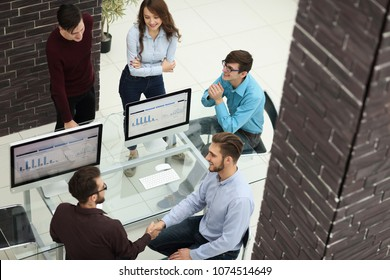 Group of creative business people having meeting in office