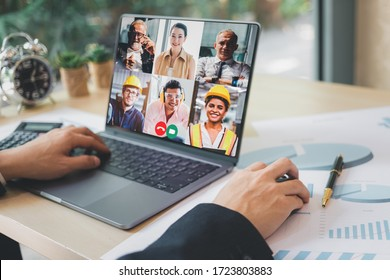 Group of creative construction engineer using laptop for video conference meeting and discussion about new project. Work from home, Working remotely during corona virus crisis, New normal working.