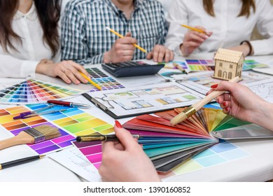Group of creative designers working in office with color palettes