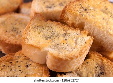 Group of crispy toasted croutons with black salt