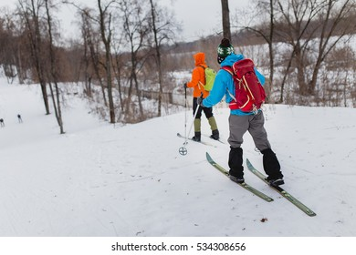 group cross country skiers with backpacks walking and exercise in the winter forest