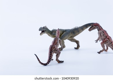 Group of Cryolophosaurus dinosaur in attack position for a allosaurus with white background