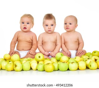 Group of cute  babies, surrounded by apples over white.