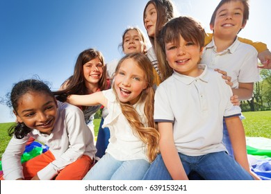 Group of cute kids having fun together in the park