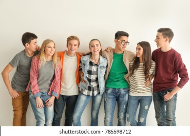 Group of cute teenagers on white background