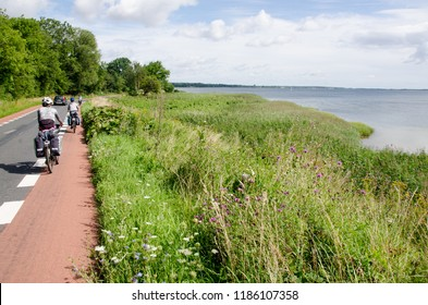 Group of  cycle tourist on the scenic countryside road in Denmark - island Mon (near Bredshave).