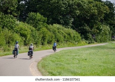 Group of cycle tourist on the scenic countryside road in Denmark - island Mon.