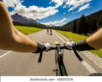 Group of cyclist on mountaionous road. Original point of View POV, view in first person. Focus on hands of cyclist,