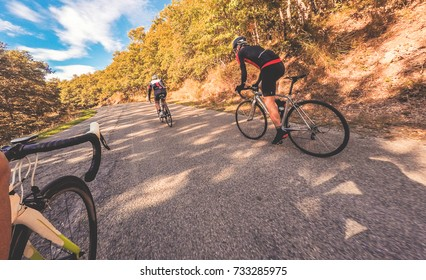 Group of cyclist in a sunny day. Autumn season