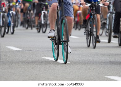 Group of cyclists go to the city