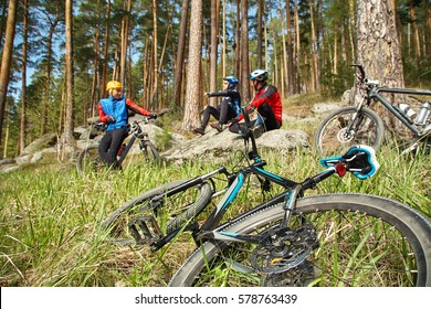 group of cyclists on a halt. team outdoors. mountain bike