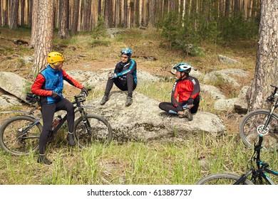 group of cyclists on a halt. team outdoors. mountain bike