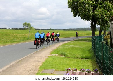A group of cyclists on the road