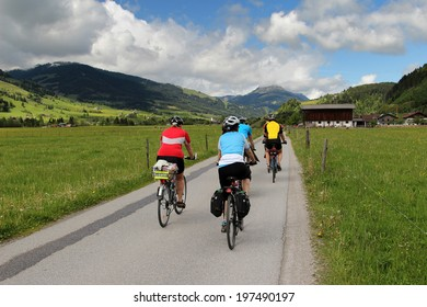 Group of cyclists riding along the cycle path in the Austrian Alps