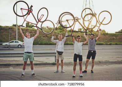 Group of cyclists riding fixed gear bikes on the road