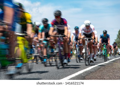 Group of cyclists in a road race stage.