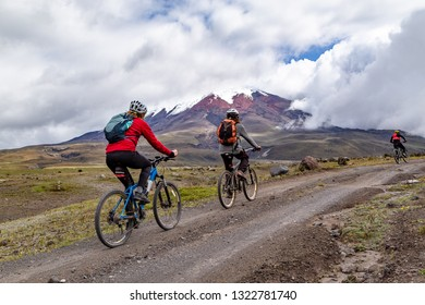 A Group of cyclists travels through the Cotopaxi National Park